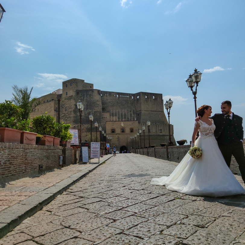 Just married couple at front of Ovo Castle, Napoli