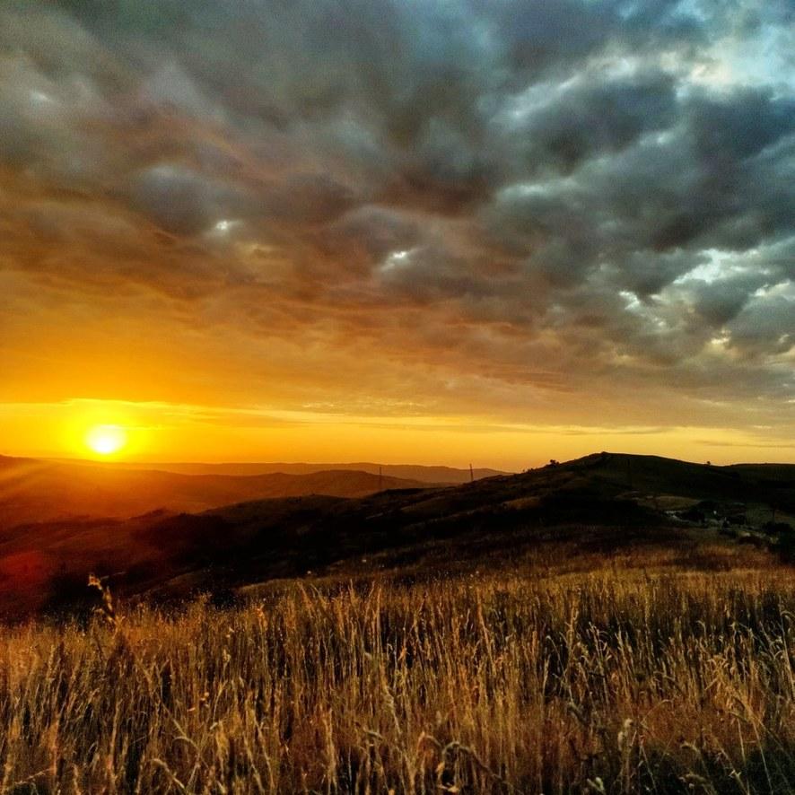 Sunrise at Tuscany fields